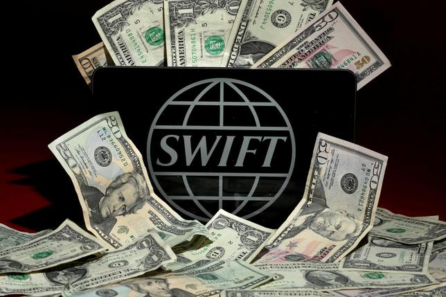 The SWIFT logo is pictured in this photo illustration taken April 26, 2016. REUTERS/Carlo Allegri/Illustration/File Photo