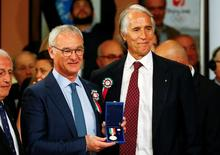 Leicester City manager Claudio Ranieri (L) poses with the Golden Palm award next to the Italian National Olympic Committee (CONI) President Giovanni Malago during a ceremony in Rome, Italy May 9, 2016. REUTERS/Tony Gentile