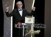 "Director Ken Loach, Palme d'Or award winner for his film ""I, Daniel Blake"", reacts during the closing ceremony of the 69th Cannes Film Festival in Cannes, France, May 22, 2016.              REUTERS/Eric Gaillard"