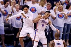 May 24, 2016; Oklahoma City, OK, USA; Oklahoma City Thunder guard Russell Westbrook (0) and guard Cameron Payne (left) celebrate during the fourth quarter against the Golden State Warriors in game four of the Western conference finals of the NBA Playoffs at Chesapeake Energy Arena. Mandatory Credit: Kevin Jairaj-USA TODAY Sports