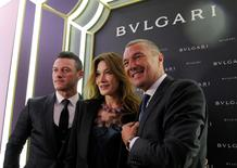 Actor Luke Evans, former French president Nicolas Sarkozy's wife Carla Bruni-Sarkozy and Bulgari Chief Executive Jean-Christophe Babin pose during a ribbon cutting ceremony to celebrate the opening of a new Bulgari store in Moscow, Russia, May 24, 2016. REUTERS/Maxim Shemetov