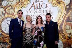 """Cast members (L-R) Sacha Baron Cohen, Mia Wasikowska, Anne Hathaway and Johnny Depp pose at the premiere of """"Alice Through the Looking Glass"""" at El Capitan theatre in Hollywood, U.S., May 23, 2016. REUTERS/Mario Anzuoni"""