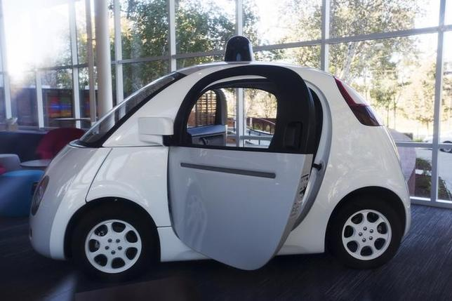 A Google self-driving car is seen inside a lobby at the Google headquarters in Mountain View, California November 13, 2015. REUTERS/Stephen Lam