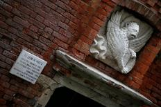 A bas-relief of the Lion of St. Mark is seen over a door at the Venice lagoon, Italy, April 23, 2016. REUTERS/Alessandro Bianchi