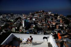 A woman sits on a terrace at Tiki hostel in Cantagalo favela, in Rio de Janeiro, Brazil, April 16, 2016.  REUTERS/Pilar Olivares