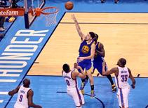 May 28, 2016; Oklahoma City, OK, USA; Golden State Warriors guard Klay Thompson (11) shoots past Oklahoma City Thunder guard Russell Westbrook (0)) during the second half in game six of the Western conference finals of the NBA Playoffs at Chesapeake Energy Arena. Mandatory Credit: Kevin Jairaj-USA TODAY Sports