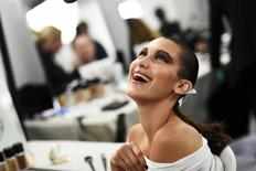 Model Bella Hadid smiles as she has her make-up applied inside Blenheim Palace ahead of a fashion show presenting the Dior, Cruise 2017 Collection, in Woodstock, Britain May 31, 2016.      REUTERS/Dylan Martinez