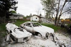 A burnt automobile and boat are seen as thousands of evacuees who fled a massive wildfire begin to return to their homes in Fort McMurray, Alberta, Canada June 1, 2016. REUTERS/Topher Seguin