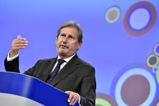 European Neighbourhood Policy and Enlargement Negotiations Commissioner Johannes Hahn gestures during a news conference at the European Commission headquarters in Brussels, Belgium, November 10, 2015. REUTERS/Eric Vidal