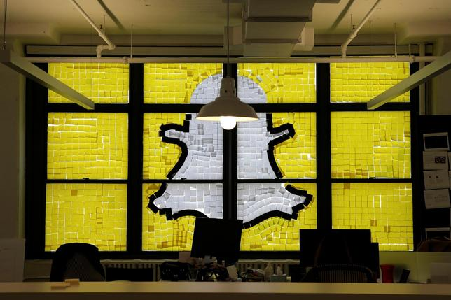 An image of the Snapchat logo created with Post-it notes is seen in the windows of Havas Worldwide at 200 Hudson Street in lower Manhattan, New York, U.S., May 18, 2016. REUTERS/Mike Segar