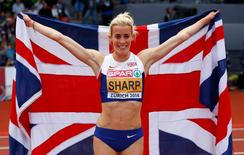 Lynsey Sharp of Britain celebrates after finishing second in the women's 800 metres final during the European Athletics Championships at the Letzigrund Stadium in Zurich August 16, 2014. REUTERS/Phil Noble