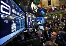 Traders gather at the booth that trades Abbott Laboratories on the floor of the New York Stock Exchange, December 10, 2012.    REUTERS/Brendan McDermid/File Photo