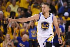 Jun 5, 2016; Oakland, CA, USA; Golden State Warriors guard Stephen Curry (30) reacts after a play during the first quarter against the Cleveland Cavaliers in game two of the NBA Finals at Oracle Arena. Mandatory Credit: Kyle Terada-USA TODAY Sports