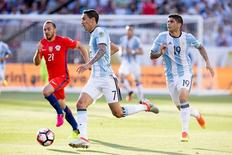 Jun 6, 2016; Santa Clara, CA, USA; Argentina midfielder Angel Di Maria (7) dribbles the ball against Chile midfielder Marcelo Diaz (21) with Argentina midfielder Ever Banega (19) during the first half during the group play stage of the 2016 Copa America Centenario at Levi's Stadium. Mandatory Credit: Kelley L Cox-USA TODAY Sports