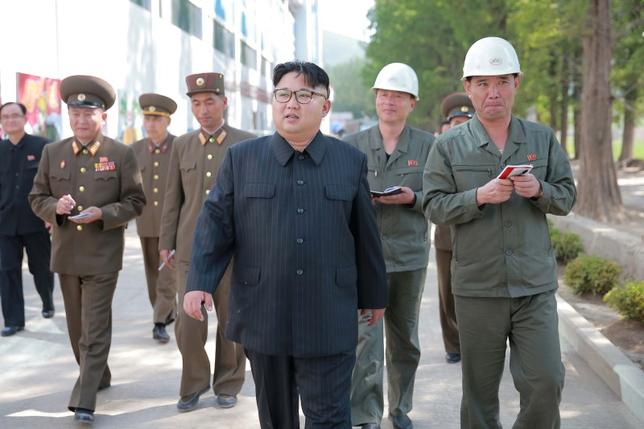 North Korean leader Kim Jong Un visits the construction site of Ryongaksan soap factory in this undated photo.    KCNA/ via REUTERS
