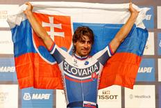 Sep 27, 2015; Richmond, VA, USA; Peter Sagan of Slovakia celebrates with a Slovakian flag on the medals podium prior to receiving the gold medal in the men's elite race as part of the UCI road world championships 2015 at the Richmond Road Circuit. Mandatory Credit: Geoff Burke-USA TODAY Sports