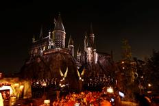 """Guests wait by a reproduction of Hogwarts Castle during a special preview opening of """"The Wizarding World of Harry Potter"""" attraction at Universal Studios Hollywood in Universal City, California April 5, 2016. REUTERS/Mario Anzuoni"""