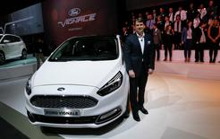 Jim Farley, executive vice president and president of Ford EMEA poses next to the new Ford Vignale car at the 86th International Motor Show in Geneva, Switzerland, March 1, 2016.  REUTERS/Denis Balibouse