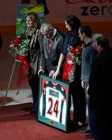 (L - R)Joanne and Len Boogaard, parents of the late Minnesota Wild defenseman Derek Boogaard, stand beside Derek's sister, Krysten, who is holding a jersey during a ceremony honoring Derek before the start of the Wild's NHL hockey game against the Calgary Flames in St. Paul, Minnesota November 27, 2011. Derek passed away in May 2011. REUTERS/Eric Miller