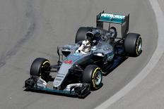 Formula One - Canadian Grand Prix - Montreal, Quebec, Canada - 10/6/16 - Mercedes F1 driver Lewis Hamilton gestures towards the crowd during the first practice. REUTERS/Chris Wattie