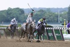 Jun 11, 2016; Elmont, NY, USA; Creator (13) ridden by Irad Ortiz battles in the front stretch with Destin (2) ridden by Javier Castellano during the 148th running of the Belmont Stakes at Belmont Park. Mandatory Credit: Anthony Gruppuso-USA TODAY Sports