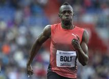 Jamaica's Usain Bolt competes in the men's 100m race. REUTERS/David W Cerny