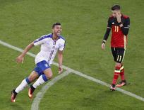 Graziano Pelle (E), da Itália, comemora gol marcado contra a Bélgica pela Eurocopa, em Lyon. 13/06/2016 REUTERS/Max Rossi