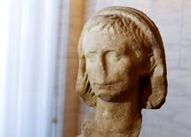 """A marble head named the """"Augusto di Nepi"""" and representing young emperor Augustus is seen during a ceremony for its restitution to Italy by Belgian authorities in Rome , Italy June 14, 2016. REUTERS/Tony Gentile"""