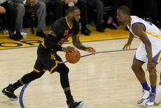 Cleveland Cavaliers forward LeBron James (23) moves the ball against Golden State Warriors  forward Harrison Barnes (40) during the first half in game five of the NBA Finals at Oracle Arena. Mandatory Credit: Cary Edmondson-USA TODAY Sports