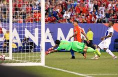 Chile forward Eduardo Vargas (11) scores past Panama goalkeeper Jaime Penedo (1) and defender Luis Henriquez (17) during the first half in the group play stage of the 2016 Copa America Centenario at Lincoln Financial Field. Mandatory Credit: Bill Streicher-USA TODAY Sports