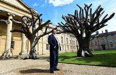 Artist Ai Weiwei from China poses with work from his exhibition in the grounds of Downing College in Cambridge, Britain, June 15, 2016. REUTERS/Alan Walter
