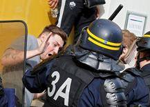Football Soccer - Euro 2016 -  Lille, France  15/6/16  Police and fans clash in the center of Lille, France.      REUTERS/Pascal Rossignol