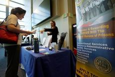 A job seeker listens to a recruiter from the Federal Bureau of Prisons at a health care job fair sponsored by the Colorado Hospital Association in Denver, U.S., May 9, 2016.  REUTERS/Rick Wilking