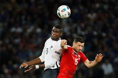 Football Soccer - Switzerland v France - EURO 2016 - Group A - Stade Pierre-Mauroy, Lille, France - 19/6/16 France's Paul Pogba in action with Switzerland's Blerim Dzemaili  REUTERS/Gonzalo Fuentes Livepic