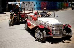 Palestinian Munir Shindi, 36, drives a replica of a 1927 Mercedes Gazelle that he built from scratch, on a street in Gaza City June 19, 2016. REUTERS/Mohammed Salem