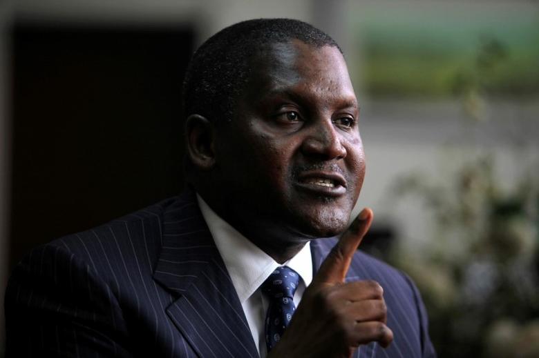 Africa's richest man got a fistful of dollars in Nigerian currency
