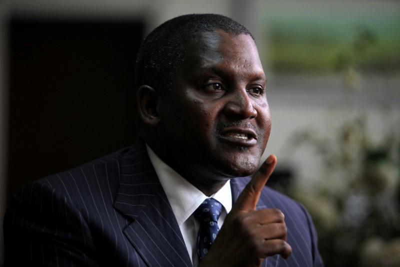 Insight - Africa's richest man got a fistful of dollars in Nigerian