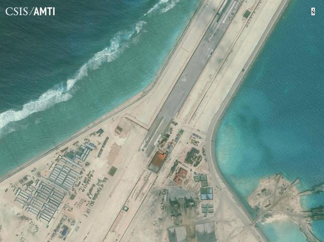 China brushes off doubts over aid on South China Sea, says it is growing