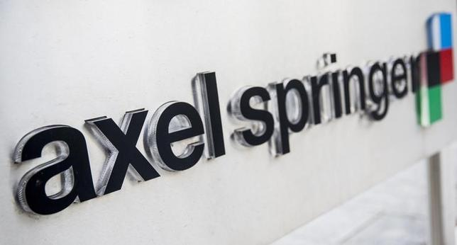 The logo of the German publisher Axel Springer is seen outside its headquarters in Berlin in this August 7, 2013 file photo. REUTERS/Thomas Peter