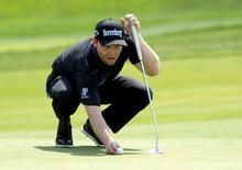 Jun 19, 2016; Oakmont, PA, USA; Branden Grace lines up a putt on the 2nd green during the final round of the U.S. Open golf tournament at Oakmont Country Club. Mandatory Credit: Michael Madrid-USA TODAY Sports