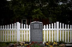 A headstone stands in a visitor area on Hart Island, the former location of a prison and hospital that is a potter's field burial site of as many as one million people, in New York, United States June 23, 2016.  REUTERS/Mike Segar