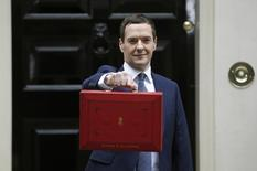 Britain's Chancellor of the Exchequer, George Osborne, holds up his budget case for the cameras as he stands outside number 11 Downing Street  in London, Britain July 8, 2015.   REUTERS/Peter Nicholls