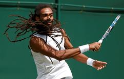 Britain Tennis - Wimbledon - All England Lawn Tennis & Croquet Club, Wimbledon, England - 28/6/16 Germany's Dustin Brown in action against Serbia's Dusan Lajovic REUTERS/Paul Childs