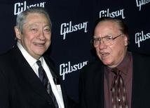 Scotty Moore (L) who played guitar for the late Elvis Presley and bluegrass music icon Earl Scruggs pose together February 26, 2002 in Hollywood. REUTERS/Fred Prouser