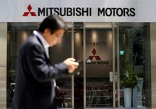 A man walks in front of an entrance of Mitsubishi Motors Corp's headquarters in Tokyo, Japan, May 13, 2016. REUTERS/Issei Kato/File Photo