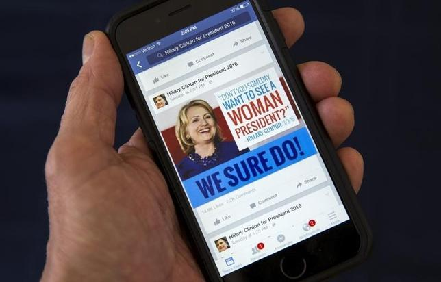A mobile phone shows a Facebook page   promoting Hillary Clinton for president in 2016, in this photo illustration taken April 13, 2015. REUTERS/Mike Segar