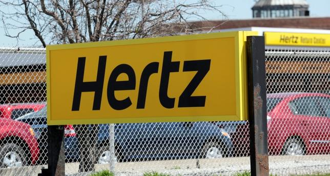A Hertz rental car sign is placed outside a rental lot near Detroit Metropolitan airport in Romulus, Michigan May 9, 2011. REUTERS/Rebecca Cook