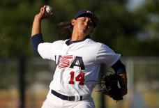Jul 22, 2015; Toronto, Ontario, CAN; United States starting pitcher Kelsie Whitmore (14) delivers a pitch in the first inning against Cuba during the 2015 Pan Am Games at Ajax Pan Am Ballpark. USA beat Cuba 11-0. Mandatory Credit: Tom Szczerbowski-USA TODAY Sports
