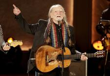 Singer Willie Nelson performs during a concert honoring him as the recipient of the Library of Congress' Gershwin Prize for Popular Song in Washington, U.S. on November 18, 2015. To match Feature USA-INDEPENDENCEDAY/NELSON      REUTERS/Joshua Roberts/File Photo