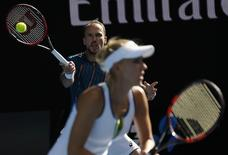 Brazil's Bruno Soares hits a shot behind his partner Russia's Elena Vesnina during their mixed doubles final at the Australian Open tennis tournament at Melbourne Park, Australia, January 31, 2016. REUTERS/Issei Kato